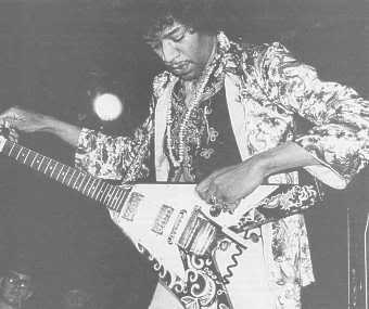 jimi_hendrix_withhispsychedelicflyingvguitar1967