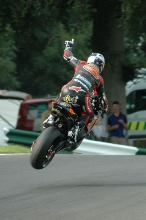 nicely_timed_sports_photos_motorbike_racer_in_the_air