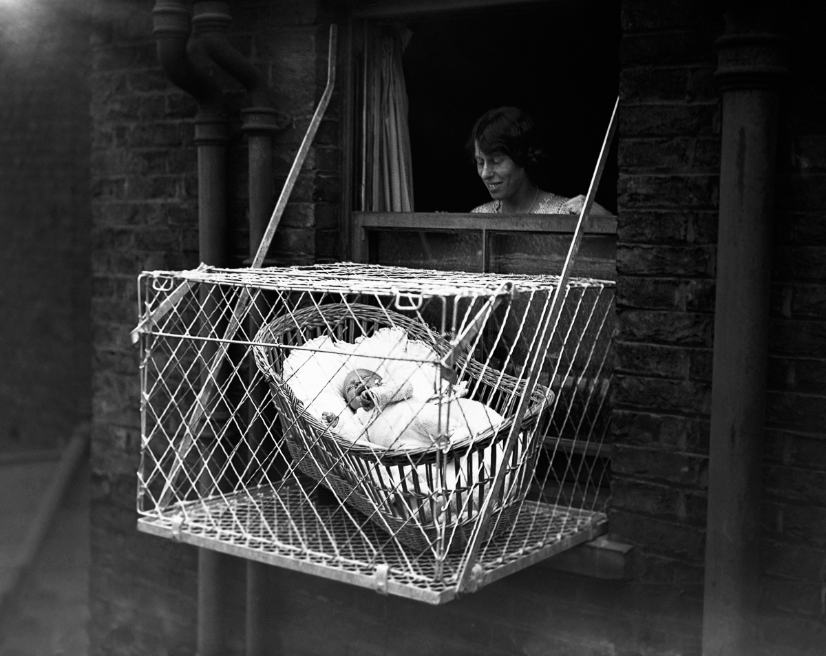 Baby in Cage Hung Out of Window