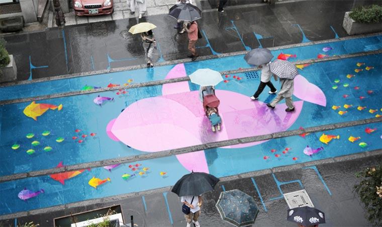 Малюнки на дощовому асфальті
