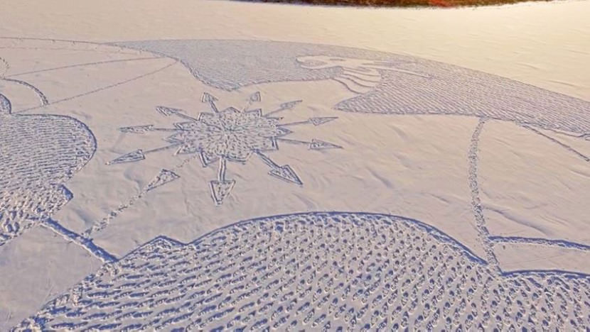 Artist-makes-giant-snow-dragon-by-walking-in-the-cold-all-day1-830x468
